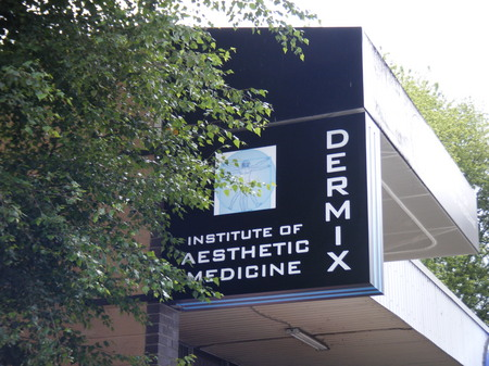 Dermix Projecting Sign
